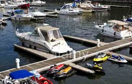 Boats and jet-skis are secured to the docks in Jacques-Cartier Basin, Montreal. Image shot 08/2009. Exact date unknown.
